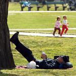 Brad Robbins of Boston leaned his legs against an elm tree in Boston Common while using his cellphone on the first day of spring.