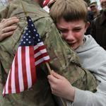 Robert McCarthy of Braintree greeted his son Liam, 10, at the Braintree Armory during the homecoming from Afghanistan of Company C, 182d Infantry Regiment of the Massachusetts National Guard.