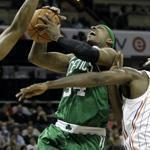 The Celtics' Paul Pierce is fouled as he drove to the basket in the second half of the Celtics' 102-95 victory.