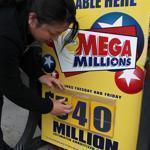A sign outside a Boston store showed the new jackpot for Friday's Mega Millions drawing.
