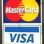 A MasterCard and Visa sticker on a window of a store in Niles, Illinois.
