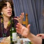 Ann Silverman and members of her book club eat a Balkan meal while discussing the book,