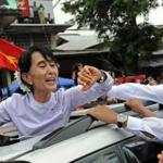 Myanmar opposition leader Aung San Suu Kyi waved to the crowd after speaking at the National League for Democracy  headquarters in Yangon.