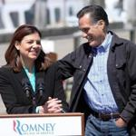 Republican presidential candidate Mitt Romney embraced New Hampshire Republican Sen. Kelly Ayotte Monday Portsmouth, N.H. after she introduced him to speak at the state fishing pier.