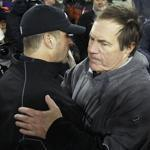 Ravens head coach John Harbaugh, left, lost to Bill Belichick and the Patriots in the AFC title game last season.