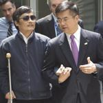 Chen Guangcheng (left) spoke with US ambassador to China Gary Locke as they left the embassy for a hospital in Beijing on May 2, 2012.