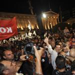 The head of Greece's Syriza party, Alexis Tsipras (giving the thumbs-up sign), celebrated with supporters in Athens Sunday.