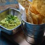 Guacamole comes in a number of versions. The best is just avocado, cilantro, salt, and onion.