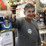 Irina Karaivanova Kotzabaldiris, 62, owner of the Star K Gas and Minimart in Belmont, tussled with a robber in her store Sunday. She tackled the suspect, who did get away with an undisclosed amount of money. One round was fired from the robber's handgun.