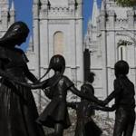 Bronze statue of mother and dancing children in front of the Salt Lake Temple on Temple Square in Salt Lake City, Utah.