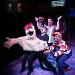 "Phil Tayler, Harry McEnerny V, and Davron S. Monroe in the Lyric Stage production of ""Avenue Q."""