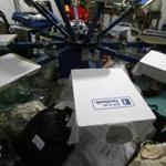 Workers in Myanmar printed Facebook logos onto T-shirts at a printing shop