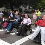 Six wheelchairs blocked Beacon Street at the corner of Park and Beacon streets.