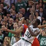 The Celtics' Brandon Bass fires a third-quarter shot over the 76ers' Evan Turner. Bass sparkled with 18 points in the quarter.