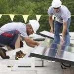 Workers from Solect Energy Development installed solar panels on a commercial building in Northborough.