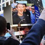 Facebook CEO Mark Zuckerberg is seen on a big screen moments after their the firm's IPO in New York.