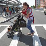 Kim Shipley navigated Boston with daughters Coraline, 2, and Arya, 7 months.