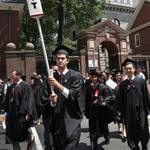 Harvard graduates, class of 2012, marched across Massachusetts Avenue Thursday.