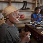 Lucy Wanjiku at Njabini Apparel, a nonprofit cofounded by Mike Behan (below) that sells handcrafted goods made by landless and handicapped mothers in the Kenyan settlement.
