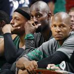 With the outcome long decided, (left to right) Rajon Rondo, Paul Pierce, Kevin Garnett, and Ray Allen watch the end of Game 1.