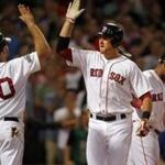 Kevin Youkilis congratulated Will Middlebrooks after Middlebrooks hit a home run in fourth inning.