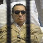 Hosni Mubarak laid on a gurney inside a barred cage in thecourthouse in Cairo, Egypt, on Saturday.