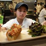 "Gayle Yu, a student from the Philippines, set out a lobster roll in the Chatham Bars Inn. ""It's exciting working here,"" she said."