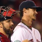 Clay Buchholz (right) was charged up with batterymate Kelly Shoppach after his four-hit, complete-game shutout against the Orioles.