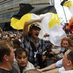 Russian nationalists marched through the crowd during an anti-government protest in Moscow today.
