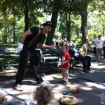 The author's son, Ben, happened onto a street performer and into the act in Central Park.