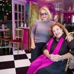 Deborah Hughes (standing) and Mary-Catherine Deibel, friends for 40 years, are marking their 30th year owning UpStairs on the Square, known for its decor (below), camp, imagination, eccentricity ­— and its food and wine.