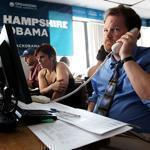 Todd Russell (right) made cold calls at Obama campaign headquarters in Manchester, N.H.