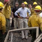 President Barack Obama spoke with firefighters as he toured the Mountain Shadow neighborhood devastated by wildfires on Friday in Colorado Springs.