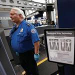 A sign at a Transportation Security Administration checkpoint instructed passengers about the use of the full-body scanner at O'Hare International Airport.