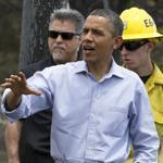 President Barack Obama talked with firefighters as he toured the Mountain Shadow neighborhood devastated by wildfires in Colorado Springs, Colo.