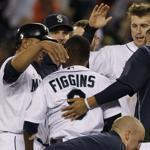 Seattle's Chone Figgins was mobbed by teammates after he hit a sacrifice fly in the 11th inning to beat the Red Sox.