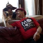 Danny Klein, bassist for the J. Geils Band, posed with his dog, Harlow, at his home in Boston. Harlow receives stem cell treatments at the Angell Animal Medical Center for dysplasia in her elbows.