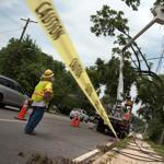 A utility worker in Bethesda, Md., stabilized a power line Sunday that was damaged in a massive storm that swept through the region Friday. More storms struck on Sunday.