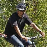 Barack Obama rode alongside daughter Malia during their 2011 vacation on Martha's Vineyard.