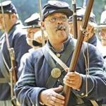 Paul Mello inspected rifles at Quabbin Civil War Remembrance Day. He got involved with the sponsor group in 1995.