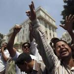 Egyptians chanted slogans in front of the presidential palace in Cairo Sunday.