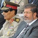 In Cairo Monday, Field Marshal Hussein Tantawi (left) and President Mohamed Morsi (center) attended a graduation.