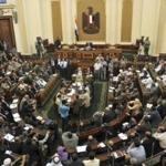 The Egyptian parliament met briefly in defiance of of ruling from the country's high court that invalidated the chamber.