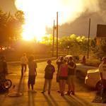 People watched the flames shoot up from a derailed freight train. Norfolk Southern said it appeared about 11 cars of a southbound train derailed around 2 a.m. near Interstate 71, southeast of the Ohio State University campus.