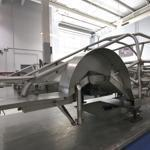 The steel framework of a car sits in the chassis shop at Hendrick Motorsports in Concord, N.C.