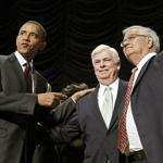 Senator Christopher Dodd (center), and Representative Barney Frank (second from right) celebrated their bill in 2010.