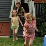 """Double Time"" author Jane Roper and her husband, Alastair Moock, with their now 5-year-old twins, Clio (in yellow) and Elsa, at their Medford home."