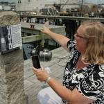 Gloucester Mayor Carolyn Kirk pointed to marine railways at a stop along the city's new harborwalk.