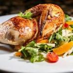 Roast chicken with a salad of watercress and citrus.