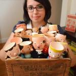 Sandy Machado, with her bounty of egg cups.